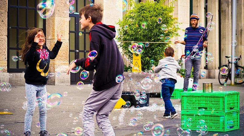 Kids Playing with Bubbles Downtown Photo