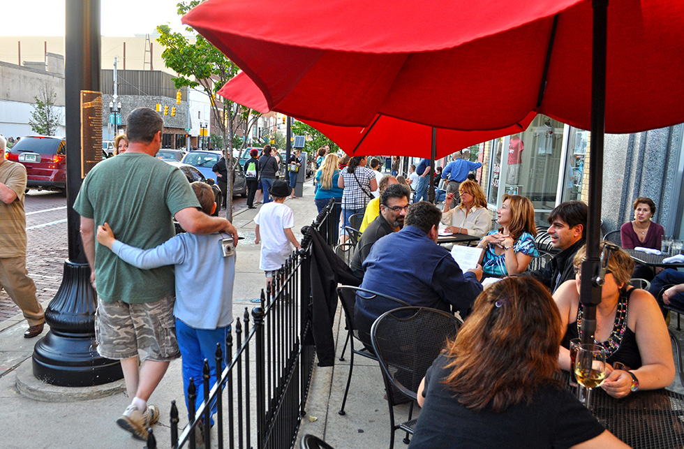 Community Wealth - City Sidewalk with restaurant seating