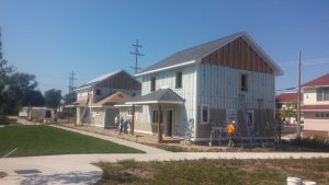 A pair of houses under construction show the insulation and air sealing.